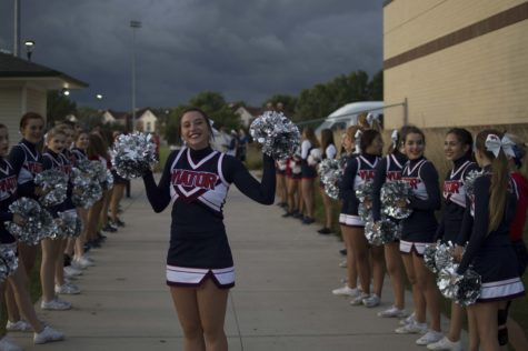 Cheer and dance teams split spotlight with spirit in sports