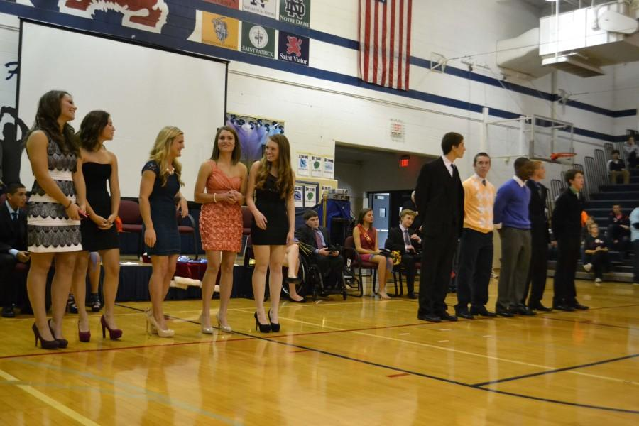 The 2012 senior homecoming court nominees await the announcement of the winners.