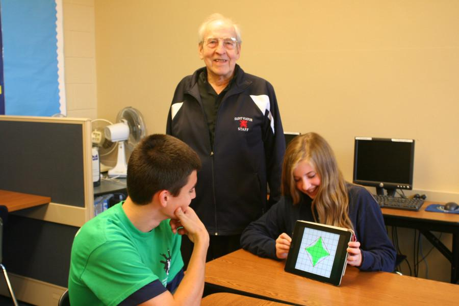 Fr. Perham helps students in the Math Lab.