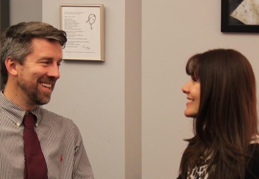 Christian Service coordinator Mr. Hisgen converses  with his assistant Mrs. Leudo.