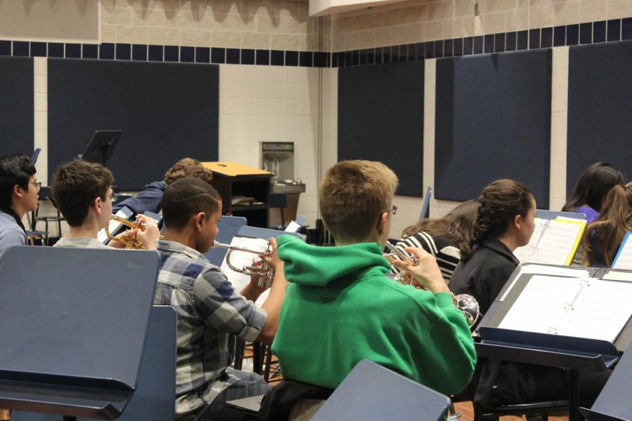 """Mrs. Sandrock leads the pit orchestra in a rehearsal of """"Seventy-Six Trombones"""""""