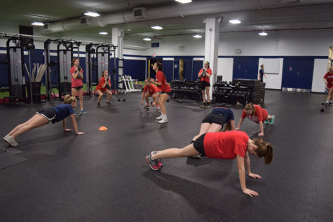 Students work out for their respective sports.