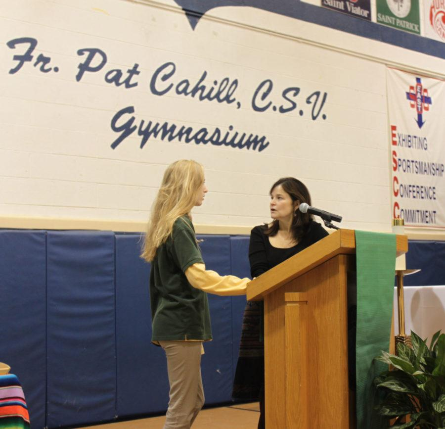 Mrs. Devroy and Eleanore Kelleher discuss petitions before Mass.