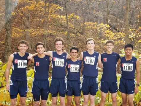 Cross country team poses at State.