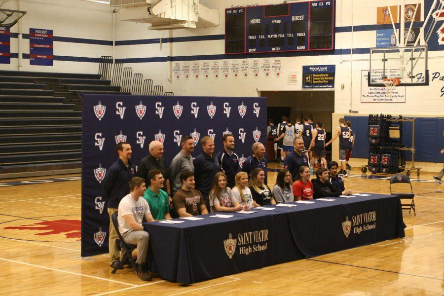 Students+with+their+respective+parents+and+coaches+at+the+National+Signing+Day+Ceremony.+