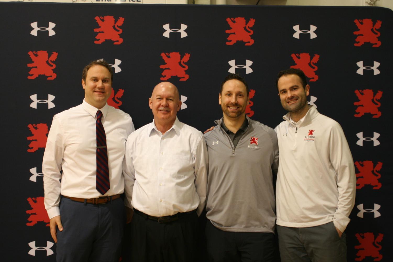 Mr. Joe Majkowski poses alongside three of his past players turned coworkers.