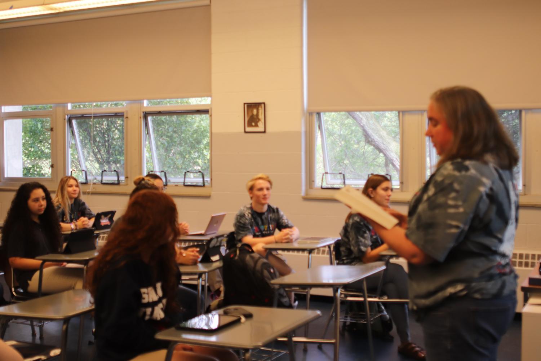 Mrs. Perez leads theology class