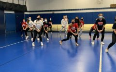 Members of the dance team prepare for the season after clearance from the athletic department.