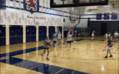 The girls basketball team runs shooting drills at practice.