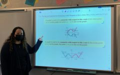 Ms. Embree shows off her current graphing lesson.
